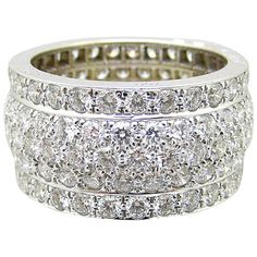 Cartier Nigeria Diamond Band   From a unique collection of vintage band rings at https://www.1stdibs.com/jewelry/rings/band-rings/