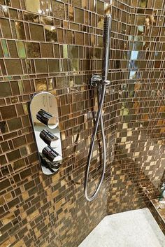Characteristic of Liberty Bronzite are the metallic shimmering caresses the surface of hand-cut glass Engineered Stone, Bathroom Trends, Shower Remodel, Recycled Glass, Cut Glass, Miami Beach, Granite, Tiles, Mosaic