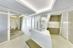 Small_kitchen_hidden_behind_one_of_the_perforated_walls-Modern Bank Interior Design - Raiffeisen in Zurich