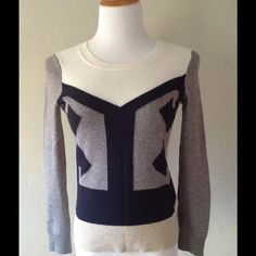 J. Crew Grey Color Block Intarsia Sweater🎉HP🎉 J.Crew's styled intarsia pullover in grey, beige, black and ivory wool/cashmere blend. Gorgeous sweater that sold out fast because it was one of the best of the season in my opinion. Dry clean. Ribbed cuffs and bottom. Soft and easy to wear. I bought it a size too small, sadly, and wore it a couple of times. Too bad. J. Crew Sweaters Crew & Scoop Necks