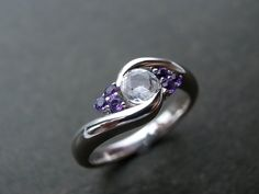 Wedding Ring with Amethyst and White Sapphire in 14K White Gold. $645.00, via Etsy.