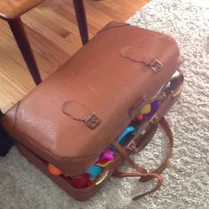 A vintage suitcase for hiding toys in the living room :)