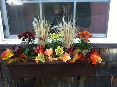Easy Fall window box. Real mums, dollar store grass & leaves. Dollar Store Halloween, Halloween Crafts, Red Party Themes, Decor Crafts, Diy And Crafts, Fall Window Boxes, Fall Decorating, Garden Inspiration, Dollar Stores