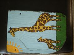 $15 Mommy and baby giraffe hand painted slate....check out my pages to see more of my work  www.facebook.com/cleanslatedesignsbyalicia  www.clean-slatedesign.com  Order a great piece of home decor today!!