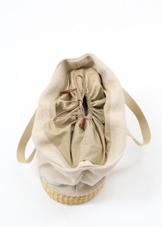 Natural straw bag with contrasting natural jute upper and drawstring top with leather inside pulls. Lined with inside pocket. Bag is aprox. tall and across. -not including straps. Made in France Jute, Straw Bag, Baby Shoes, Reusable Tote Bags, Pocket, My Style, Natural, Leather, Accessories