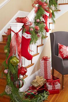 End the staircase garland with a bundle of ornaments. Hang coordinating ornaments from sheer ribbon at various heights for full effect. -- Lowe's Creative Ideas