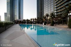scored concrete, large beach, contemporary pool