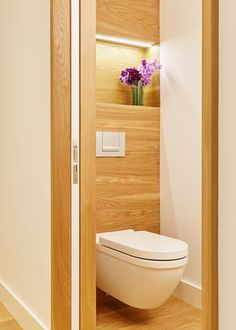 This Bathroom Uses Wood Finishes and Clean Line for a Contemporary Feel