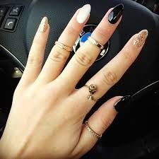 Pointy nails and cute rings!