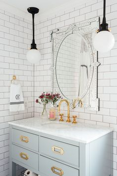 Guest bathroom in a colonial style home in Connecticut. White subway metro tiles with brass sanitary fittings taps.