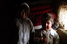 Fatima and Khalid in a refugee shelter  Refugees in Afghanistan, January 2002.