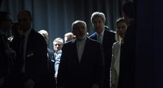 Iranian Foreign Minister Javad Zarif, centre, arrives with US Secretary of State John Kerry, background centre right.   AP Photo