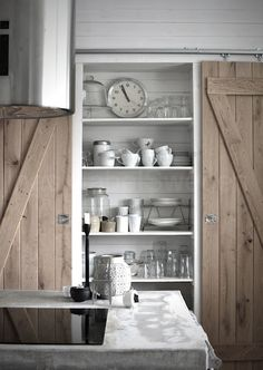 best of both worlds: open kitchen shelves and a barn door to close it off . Also concrete counter, natural wood - the style files Open Kitchen, Kitchen Pantry, Kitchen Wood, Kitchen White, Pantry Cupboard, Pantry Closet, Cupboard Doors, Kitchen Ideas, Utility Closet
