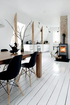 The contrast of black seats with bold white and timber, works!
