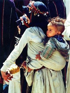 A Berber woman with her child. Atlas mountains Morocco