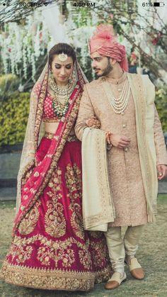 Luxurious Bridel Groom Dress In Red Lahnga Choli And Pinkish Sherwani.Bridal Lahnga Choli With Pure Dabka,Zari,Nagh,And, Threads Work.Groom Sherwani Based On Pure Jamawar Fabric In Light Pinkish Color. Indian Wedding Lehenga, Wedding Dresses Men Indian, Wedding Sherwani, Indian Bridal Outfits, Indian Bridal Wear, Bridal Lehenga Choli, Gold Lehenga, Wedding Dresses For Groom, Sherwani Groom