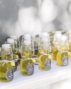 Mini bottles of homemade limoncello, a popular dessert drink, make the perfect post-wedding treat. 50 Creative Wedding Favors That Will Delight Your Guests: Photography: Jasmine Lee Photography Creative Wedding Favors, Inexpensive Wedding Favors, Wedding Gifts For Guests, Unique Wedding Favors, Wedding Party Favors, Wedding Ideas, Wedding Planning, Elegant Wedding, Wedding Table