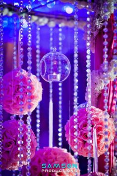 wedding reception: hanging crystals  pomanders and bulb candle holders