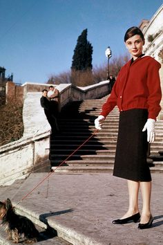 Audrey Hepburn walking her dog in Rome, 1962.