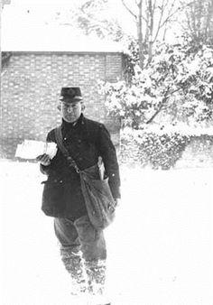 Littleton under snow with unidentified postman Date 1927