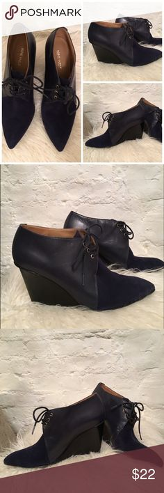 "Cool Nine West navy leather suede wedge bootie Cool leather and suede wedge bootie from Nine West. 3-1/2"" wedge heel. Some general wear as pictured - overall good condition. Nine West Shoes Ankle Boots & Booties"