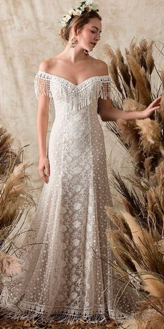 Exquisitely styled wedding gown. Love the embroidered Lace panel down the front of the dress.