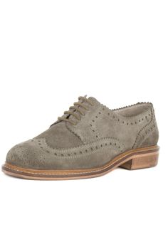 Ambush by Seychelles in taupe suede is a stylish wingtip oxford. The dainty laces and intricate detailing add a feminine touch to this menswear-inspired style. Pair these oxfords with high-waisted skinny jeans and a ruffled top for a play at flirty textures or wear them with slacks and a sweater at the office. These versatile oxfords have a 1-inch heel. Fit is true to size. Leather upper and lining; man made sole. Ambush Wing-Tip Oxford by Seychelles. Shoes - Flats - Loafers & Oxfords…