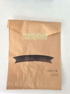 custom thank you kraft bags for weddings and birthdays, sealed with decorative washi tape. just use your home printer! we used this for a candy bar at a birthday. #craft #diy #handmade #dol