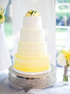The gradient from white to yellow is well executed on this wedding cake.
