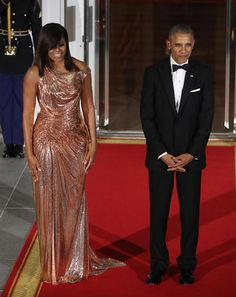 Michelle Obama shines in an Atelier Versace gown at her final State dinner, alongside husband President Barack Obama. Picture / Getty