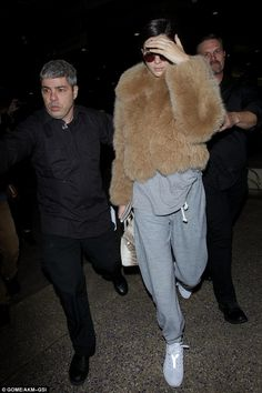 Back home: On Tuesday night, Kendall had arrived back in Los Angeles from Paris wearing a fur jacket over gray sweats and was accompanied by two bodyguards at LAX