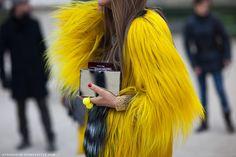 yellow jacket, silver clutch