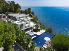 It is the best dream home I've seen so far. But it get's even better. It's located on Ibiza island in Spain. Almost $23 400 000. Whoa! Yeah, that's €18 000 000. A lot of money for single family home. But have in mind it has 22 bedrooms and 24 full bathrooms. Don't know how big exactly that family has to be. Anyway, it's a dream home, built right on the cliffs above the ocean, surrounded by the beautiful green Mediterranean vegetation, palms, cricket sounds and waves smashing in the cliffs.