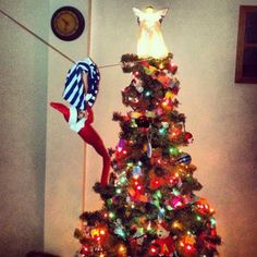 Elf on the Shelf. Underwear zip line! HA! Love the little homemade elf pajamas!