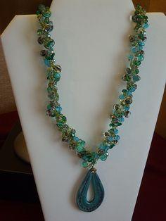 This is wire crochet using czech glass Unicorn Glass beads
