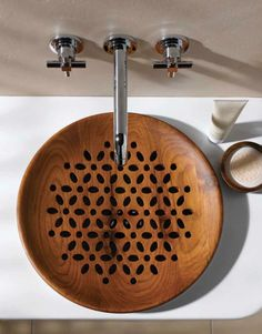 Flat wooden sink with carved detail.  I absolutely love the look (of the sink, not really anything else in this photo), but have to wonder how practical this is!  How challenging to care for?