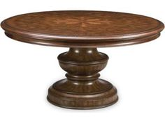 The island of Elba, off the coast of Tuscany, is a tranquil patchwork of terracotta rooftops, beaches and vineyards. The Elba Round Dining Table, too, is an island of natural beauty, with intricate twining inlays of pecan and olive ash burl adorned with singed wood, a historic decorative process.