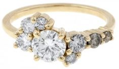 A Custom Cluster Engagement Ring with white and champagne diamonds set from light to dark. http://bario-neal.com/custom-work/custom-pieces/custom-clustered-diamond-ring-with-prongs