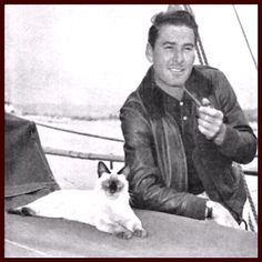 People who look like their pets: Errol Flynn's cat is just as suave and debonair as you'd expect.