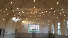 A beauitful spider canopy in warm white festoon lighting at the amazing Hastoe Village Hall.