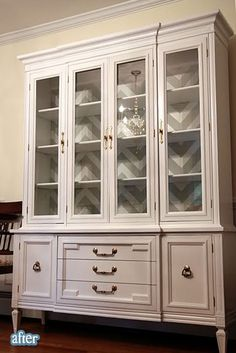 Chevron wallpaper backed china cabinet!! Oh la la