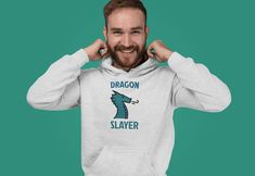 This design will add some fun to your wardrobe or it might make the perfect gift! Gaming Apparel, Got Dragons, Dragon Slayer, Graphic Sweatshirt, Sweatshirts, Gift, Sweaters, Fun, Jackets
