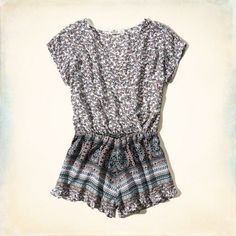 Lightweight and drapey with all-over pattern, wrap-front detail, cinched waist and ruffle hem, Imported