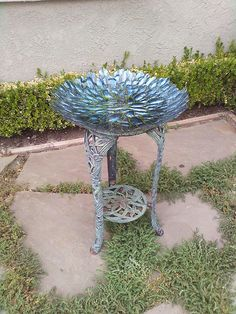Easy DIY bird bath.  Heavy shallow glass bowl from Home Goods ($17) on an old iron plant stand (orig $20).  Cheaper and prettier than ready made versions.
