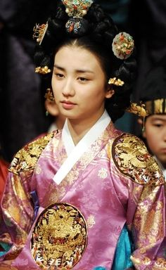 Korean Traditional Dress (Hanbok).  The hair ornaments and gold embroidery suggest a royal ensemble.