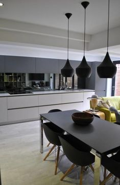 This slick modern kitchen has been designed mainly in dark grey with contrasting light base units. The dark grey handless matt cabinets fra. Kitchen Inspirations, Handleless Kitchen, White Kitchen Cupboards, Modern Kitchen, Open Plan Kitchen Living Room, Modern Grey Kitchen, Handless Kitchen, Kitchen Mirror, Light Grey Kitchens