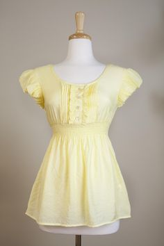"""Dressing Your Truth - Type 1 Sunshine Top  """" Like a sunny day, this Type 1 top will brighten your day and bring a smile to your face. The cotton/silk blend is light and cool, just perfect for those fun summer days.        60% Cotton, 40% Silk      Babydoll, empire waist      Gathered cap sleeve      Lace yoke in back  """""""