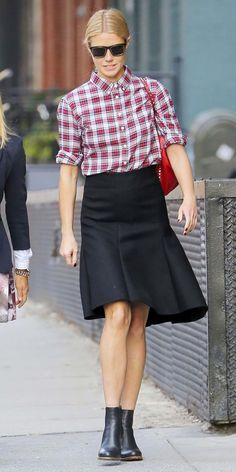 Gwyneth Paltrow streamlined her plaid look by buttoning her top up all the way and matching it with an A-line skirt and sleek booties.