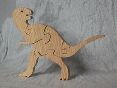 Tyrannosaurus Rex Dinosaur 3D Wooden Puzzle in by HolyokePuzzles, $19.00  Use coupon code PIN10 for 10% off anything in the Holyoke Puzzles store. #shopsmall #artisansofwmass