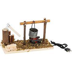 """Feuerstelle mit Axt, Größe: 12,5 x 5 x 7 cm, mit Niedervoltstecker für 4,5 V, 9 mW.Für diesen Artikel benötigen Sie den Beleuchtungs-Trafo B.-Nr. 99-84508.Diese Feuerstelle ist beleuchtet und sorgt für eine """"heimelige"""" Stimmung in Ihrer Weihnachtskrippe. Auch für Ihre Modellbaulandschaft geeignet.Tipp: Alles, was für den Bau einer Weihnachts-Krippe verwendet werden kann, ist auch für Landschaft..."""